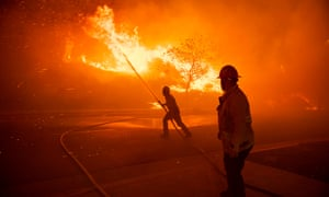 Firefighters battle the flames of the Saddlebridge fire in Sylmar, California, on 10 October.
