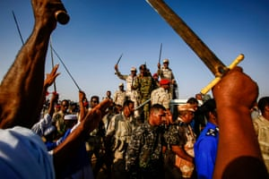 Mohamed Hamdan Dagalo, also known as Himediti, deputy head of Sudan's ruling Transitional Military Council and commander of the Rapid Support Forces  paramilitaries, rides in the back of a vehicle surrounded by RSF members and crowds of supporters in the village of Qarri.
