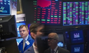 Traders and financial professionals work on the floor of the New York Stock Exchange (NYSE)
