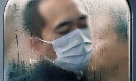 A detail from Michael Wolf's shot showing one of the 3.64m people who use Shinjuku station every day.