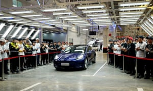 A Tesla Model 3 vehicle arrives at a delivery ceremony in Shanghai, east China, today