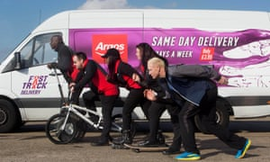 Ex-Olympic sprinter Iwan Thomas (foreground) helps launch the Fast Track service