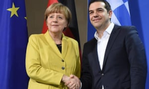 German Chancellor Angela Merkel (L) and Greek Prime Minister Alexis Tsipras (R) shake hands after a joint press conference in the Federal Chancellery in Berlin
