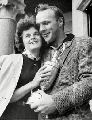 13 July 1962. Arnold Palmer with his wife Winnie after receiving his trophy for his second British Open championship in a row.
