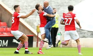 Gerhard Struber embraces his Barnsley players after Patrick Schmidt's later winner against Nottingham Forest that gave the club a chance of avoiding relegation from the Championship.