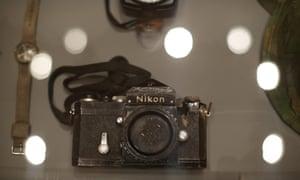 A Nikon camera body with bullet hole at Don McCullin, Tate Britain.