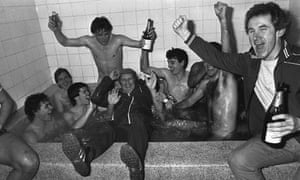 Bournemouth players and backroom staff celebrate the 2-0 victory over Manchester United in January 1984.