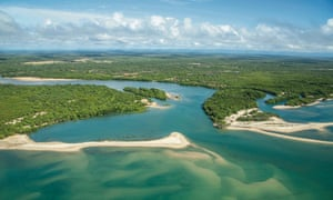 aerial view of river mouth and green coastal bushland