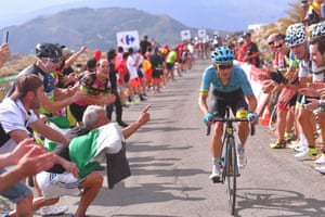 Miguel Ángel López is cheered on by fans during the 14th stage