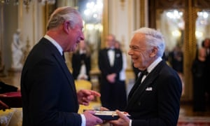 Ralph Lauren receives his honorary knighthood from the Prince of Wales.