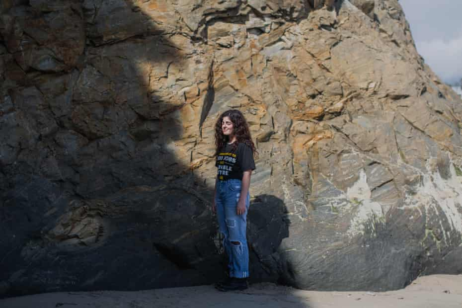 Rose Strauss, a member of the Sunrise movement, poses for a portrait at Campus Point in Santa Barbara on Thursday