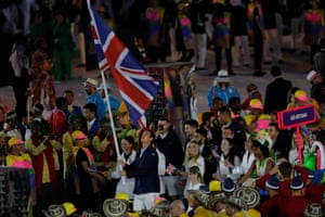 Andy Murray carries the flag as he leads out Team GB.