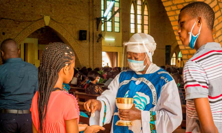 Holy Communion with face masks at a church in Kinshasa.