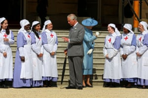 The Prince of Wales, President of the British Red Cross with Deputy President Princess Alexandra meet nurses dressed in World War 1 uniform during a garden party in honour of the society at Buckingham Palace