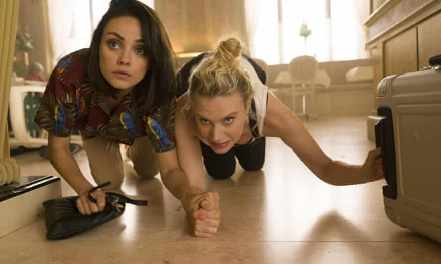 """This image released by Lionsgate shows Kate McKinnon, right, and Mila Kunis, left ( Audrey) in a scene from """"The Spy Who Dumped Me."""" (Hopper Stone/Lionsgate via AP)"""
