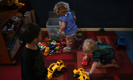 Three children play at a childcare centre