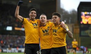 Diogo Jota celebrates scoring Wolves' first goal against Cardiff with teammates.