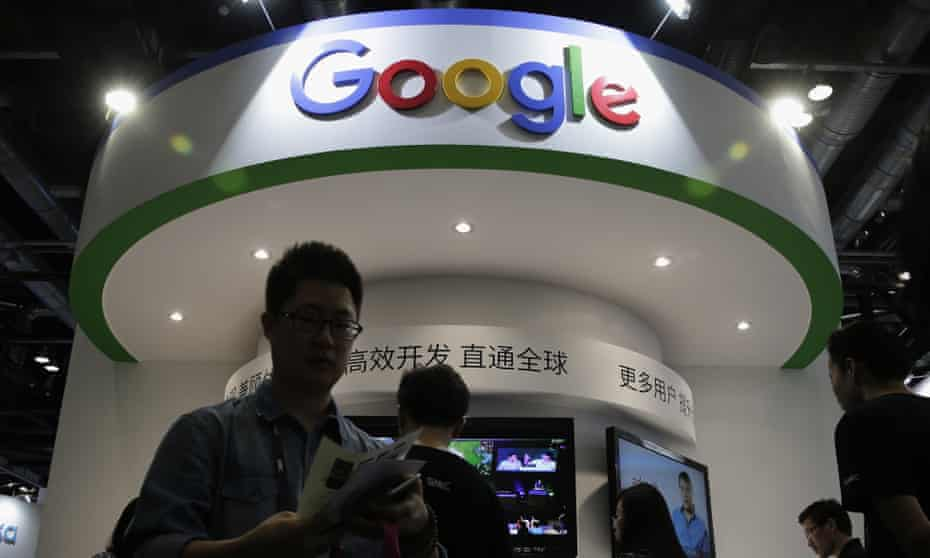 Visitors gather at a display booth for Google at a 2016 conference in Beijing.