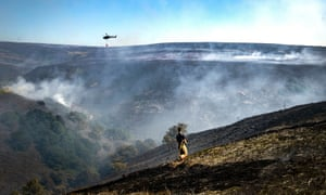 A firefighter tackles the wildfire on Saddleworth Moor