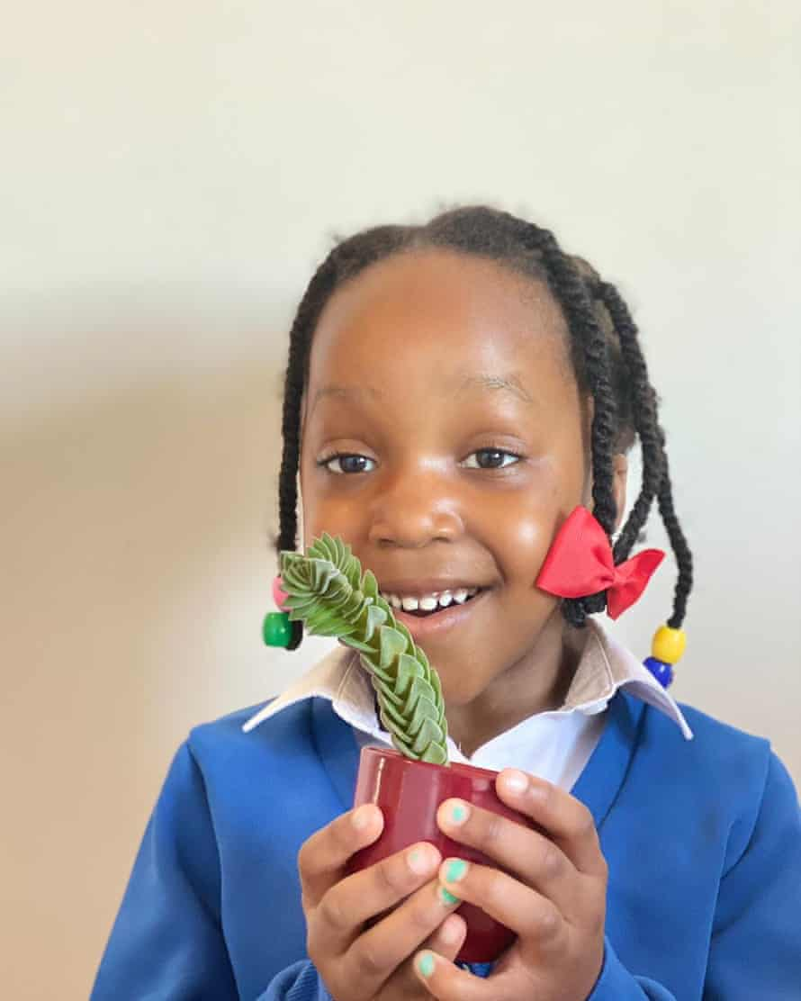 Nmeso with a plant she chose herself.