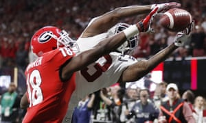 Georgia's Deandre Baker knocks the ball away from Alabama's Calvin Ridley during the second half of the NCAA college football playoff championship game on Monday in Atlanta