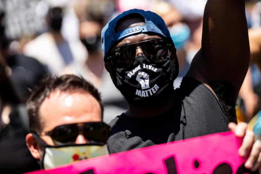A man in a Black Lives Matter mask attends a protest in Los Angeles on 14 June 2020.