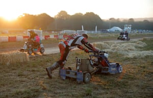 The EJH Racing mower gets pushed back to the pits after breaking down.