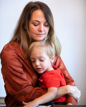 Elle Cavatore with her youngest son, Thomas, at their home in Houston, Texas.