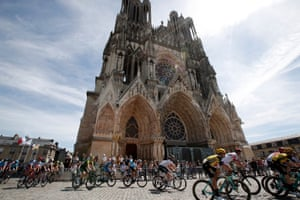 Reims, France: The pack of riders by Reims Cathedral during the 4th stage of the 106th edition of the Tour de France.