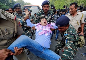 Police detain a supporter of India's main opposition Congress party in New Delhi, India