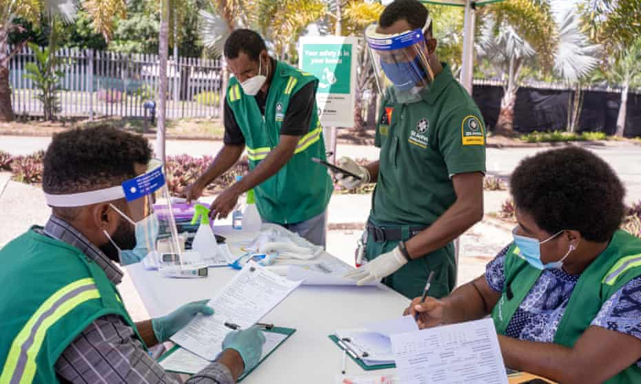 Medical workers at a drive-through Covid testing site in Port Moresby