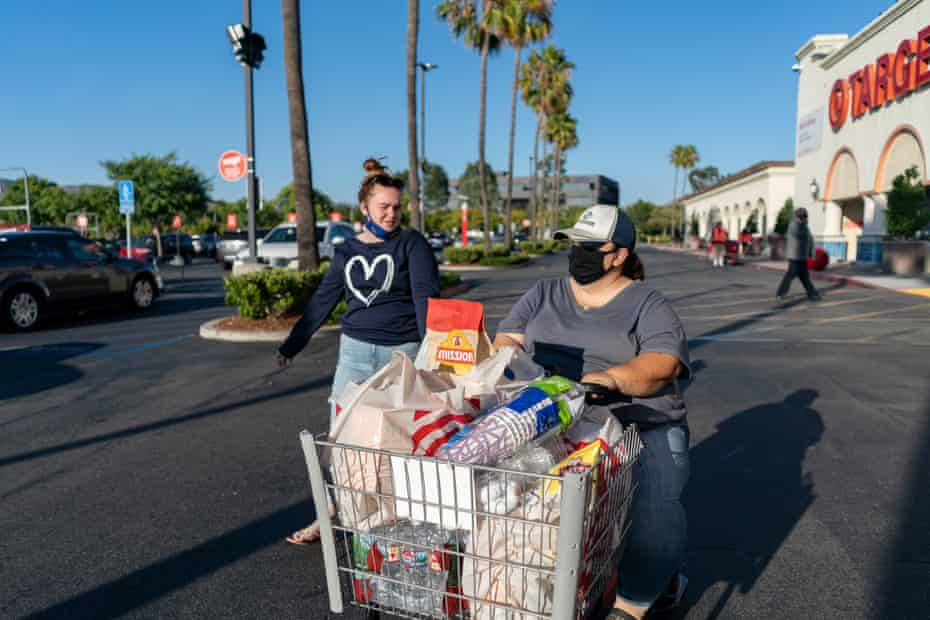 Sierra and Priscilla leave the grocery store. Orange County, California. July, 2020.