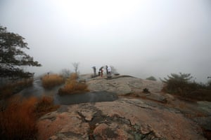 New York, US: Fog envelops a group of people at Bear Mountain State Park