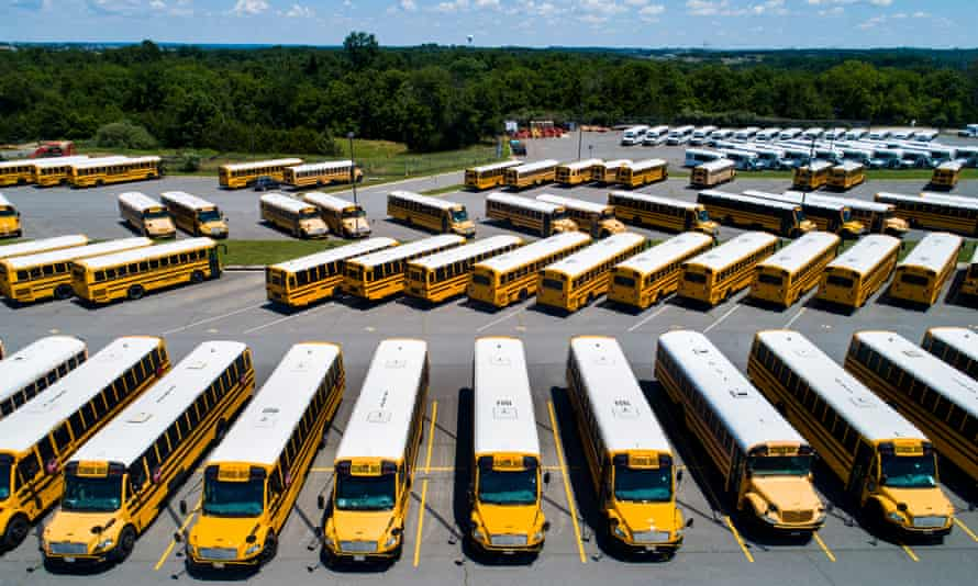 School buses parked in Leesburg, Virginia. Most vulnerable to state K-12 education cuts are school districts that serve students from low-income communities.