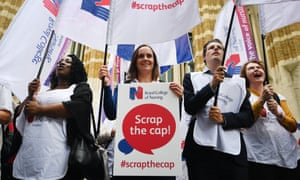 Nurses protest against the pay cap outside the Ministry of Helath in London<br>epa06052581 Nurses begin a summer of protest against the British Government's pay cap outside the Ministry of Health in central London, Britain, 27 June 2017. Media reports state that nurses and health care assistants will join protests in 30 locations across Britain, timed for the June pay day in the National Health Service (NHS), to mark the start of the Royal Colleage of Nursing's (RCN) 'summer of protest'. The RCN are calling for the British Prime Minister Theresa May to remove the one per cent pay cap the current restriction on pay increaeses that has been in place for the past seven years.  EPA/ANDY RAIN