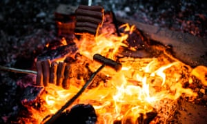 Going with a bang: roasting sausages over the flames will require a powerful red wine to finish off.