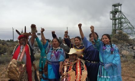 Three generations of Havasupai members demonstrate against uranium extraction outside the Grand Canyon mine site.