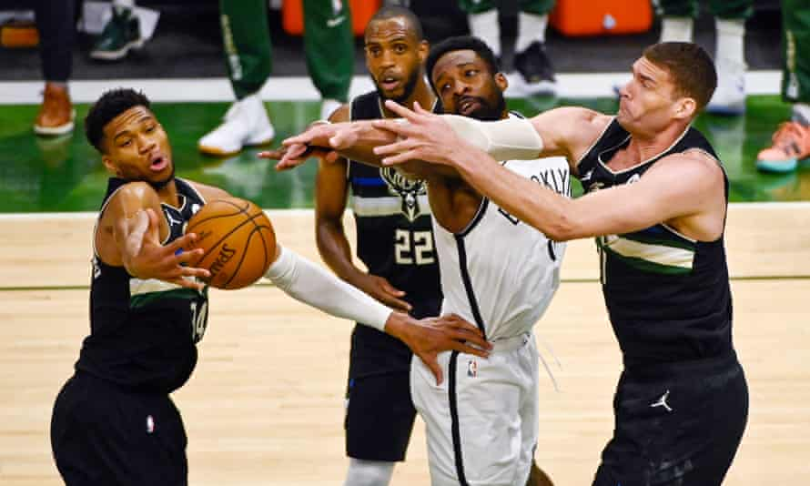 The Nets and Bucks tussle for the ball in Game 6