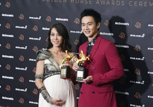 Taiwanese actors Winnie Chang and Liu Kuan-ting with their awards for best supporting roles for The Teacher and A Sun.