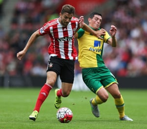 Jay Rodriguez of Southampton is challenged by Graham Dorrans.
