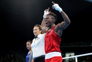 Great Britain's Nicola Adams celebrates victory over France's Sarah Ourahmoune during the women's flyweight final.