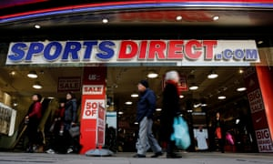 Shoppers walk past Sports Direct store in London