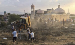 Uzbek workers clean an area of the central cemetery in Samarkand in photographs posted by the central Asian news website Fergana.ru.
