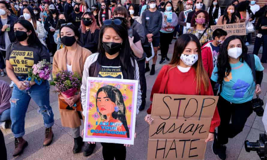 Demonstrators take part in a rally to raise awareness of anti-Asian violence in Los Angeles on 13 March.
