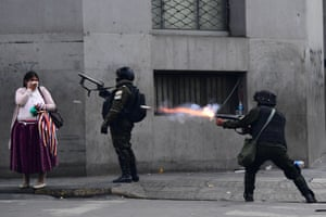 Riot police fire tear gas to disperse supporters of Bolivian ex-President Evo Morales and locals discontented with the political situation during a protest in La Paz on November 13, 2019.