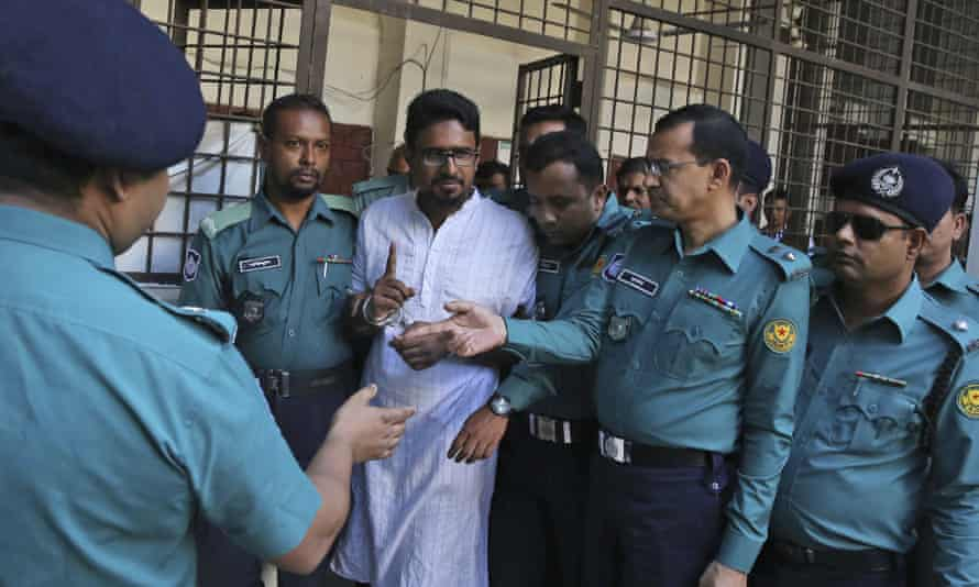 Police escort one member of an Islamist militant group in Dhaka after he was sentenced to death for an attack on a cafe in 2016