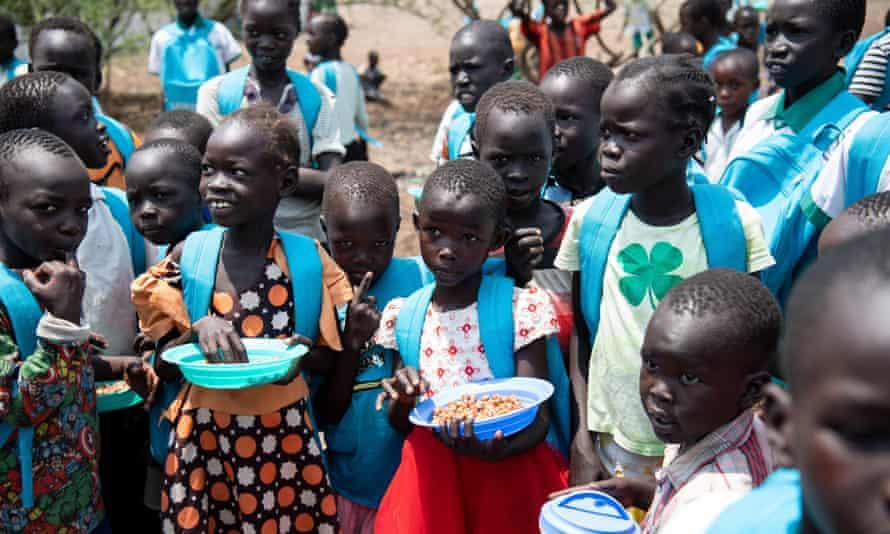 Children with blue Unicef backpacks in Kalobeyei, an overspill camp near Kakuma.