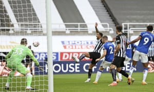 Newcastle's Callum Wilson, centre, is fouled in the penalty area.