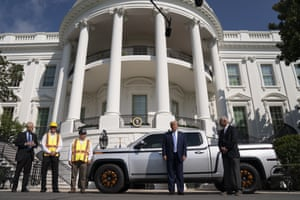 Donald Trump poses with the Lordstown Motors CEO, Steve Burns, and workers at the White House last month. The company has taken over a GM plant that closed the day Trump was inaugurated but employs only a fraction of the workers GM did.