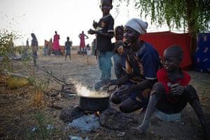 Nyaki Masha cooks an evening meal